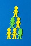 蓝色背景的五颜六色的被堆积的泡沫人民 库存图片