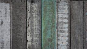 蓝色背景的被绘的老木头和板条墙壁纹理 免版税图库摄影