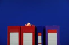 蓝色背景的黏合剂 免版税库存图片
