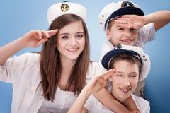 蓝色背景的水手 免版税库存照片