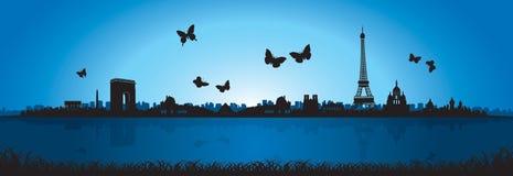蓝色背景蝴蝶巴黎地平线剪影 免版税图库摄影