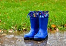 蓝色胶靴 图库摄影