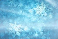 蓝色色的发光的艺术性的雪花背景 库存照片