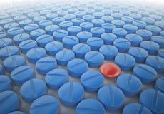 蓝色药片红色 免版税图库摄影