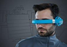 蓝色虚拟现实耳机的人反对灰色手拉的办公室 免版税库存照片