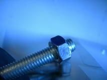 蓝色螺丝 免版税库存图片