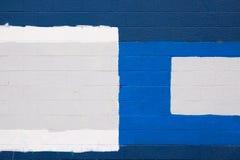 蓝色补丁程序墙壁 库存照片