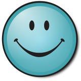 蓝色表面愉快的面带笑容 库存照片