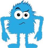 蓝色表面毛茸的妖怪翻倒 免版税图库摄影