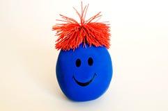 蓝色表面面带笑容 免版税库存图片