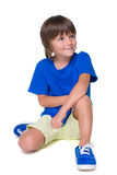 蓝色衬衣的小男孩 免版税库存图片