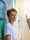 蓝色衬衣的青少年的男孩 库存照片