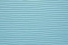 蓝色被剥离的塑料背景 免版税库存图片