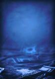 蓝色被定调子的美国货币 免版税库存照片