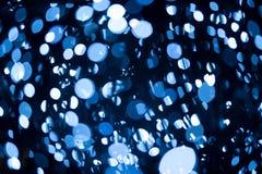 蓝色被定调子的bokeh 免版税图库摄影