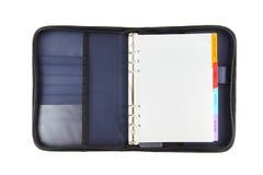 蓝色被开张的盖子直接织品笔记本 免版税库存照片