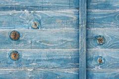蓝色被弄脏的木头 库存图片