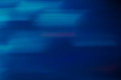 蓝色被弄脏的行动摘要背景 免版税库存图片