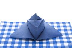 蓝色被折叠的餐巾 库存照片