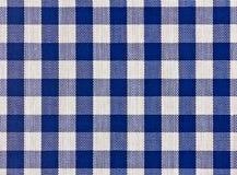 蓝色被摆正的桌布 免版税库存图片
