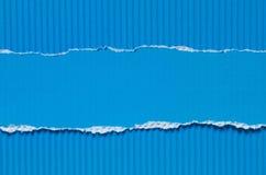 蓝色被撕毁的纸背景纹理 免版税图库摄影