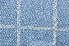 蓝色被检查的织品背景或纹理 图库摄影