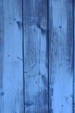 蓝色被绘的木头 库存图片