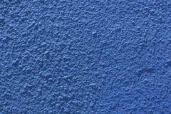 蓝色被绘的灰泥墙壁 库存照片