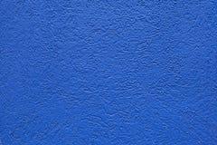 蓝色被绘的灰泥墙壁 免版税库存照片