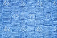 蓝色被编织的织品纹理 免版税库存图片