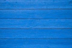 蓝色被绘的木板条背景纹理 免版税库存图片