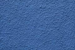 蓝色被绘的灰泥墙壁 免版税图库摄影