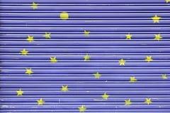 蓝色被绘的金属篱芭 免版税图库摄影
