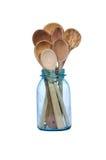 蓝色装于罐中的瓶子捞出木 免版税库存照片