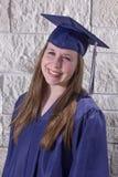 蓝色褂子的毕业生 免版税库存图片