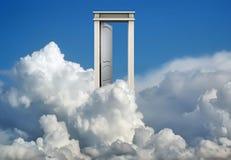蓝色覆盖门天空 库存图片