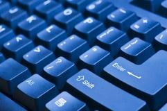 蓝色计算机键盘 免版税图库摄影