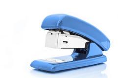 蓝色订书机 图库摄影