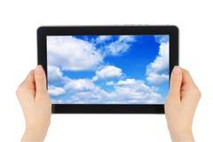 蓝色设备屏幕天空接触 免版税库存图片