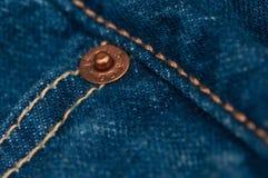 蓝色详细资料牛仔裤宏观缝长裤 免版税图库摄影