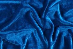 蓝色起皱纹的天鹅绒 免版税库存图片