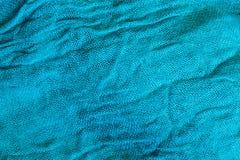 蓝色起皱纹的织品特写镜头 免版税图库摄影