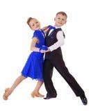 蓝色跳舞礼服的愉快的小女孩 免版税库存图片