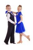蓝色跳舞礼服的愉快的小女孩 库存图片