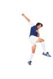 蓝色踢的足球运动员 免版税库存图片