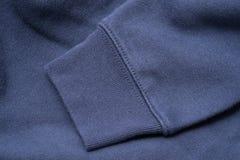 蓝色运动衫袖子  免版税库存图片