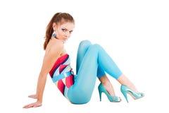 蓝色迷人的楼层女孩年轻人 库存照片