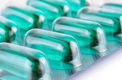 蓝色透明药片美满的医学胶囊 图库摄影