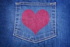 蓝色重点牛仔裤装在口袋里红色 免版税库存图片