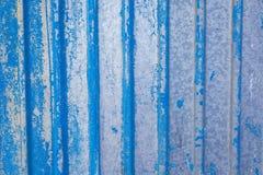 蓝色金属生锈的表面作为织地不很细背景 免版税库存照片